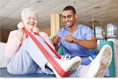 physical therapist having therapy session with elder woman